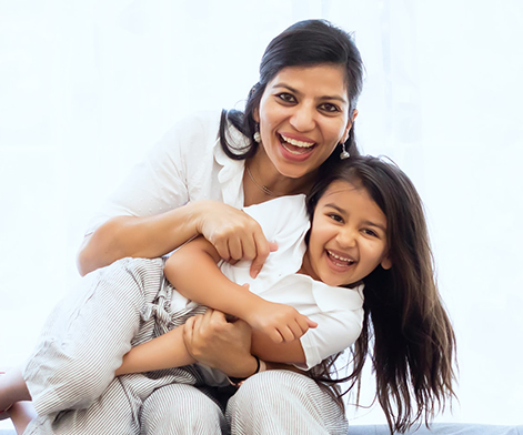 Mom and daughter smiling and laughing